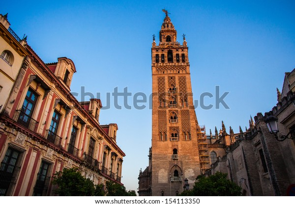 Tower of the cathedral of Sevilla at sunset in Andalucia, Spain
