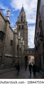 Tower of the cathedral of Toledo, Spain. Also in the picture the walkway between the cathedral and the parish house and a little of the blue sky of the Spanish winter.