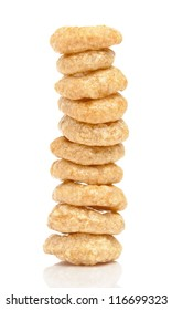 Tower of cereal rings on white background