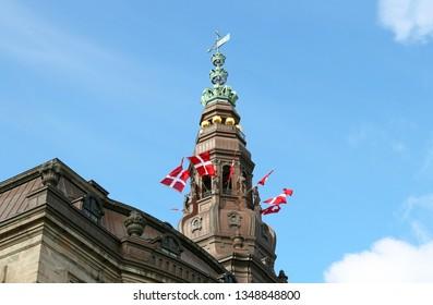 Tower of Christiansborg Castle with Danish flag. Copenhagen, Denmark.