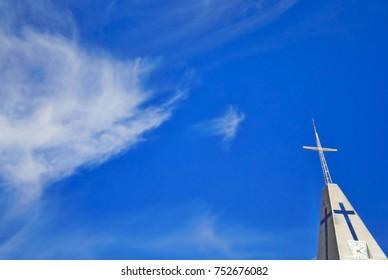 Tower of the church below wonderful blue sky