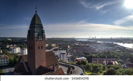 """Tower of the church named """"Masthuggskyrkan"""" in the foreground and cityscape in the background in Gothenburg, Sweden. Heat haze on part in the background of the image."""