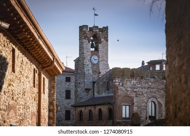 The tower with clock of the municipal building in the medieval village of Suvereto, province of Livorno, Tuscany, Italy