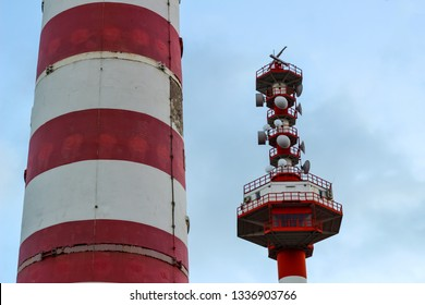 Tower communication with a variety of satellite dishes. Part of the striped lighthouse. Emergency communication for storm rescue and shipwreck