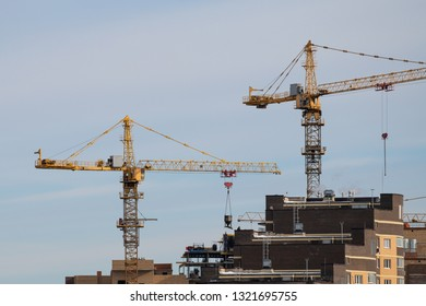 Tower construction cranes building new house