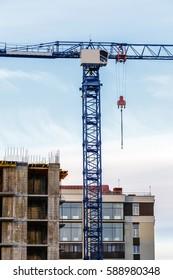 Tower crane, construction of building development, vertical image