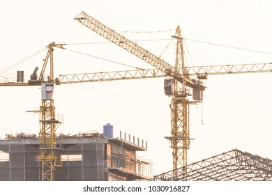 tower crane construction equipment over building construction site on white background