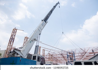 and tower crane in construction site Mobile Crane on a road working In the factory lift steel Roof frame Improve Nurturing 50T