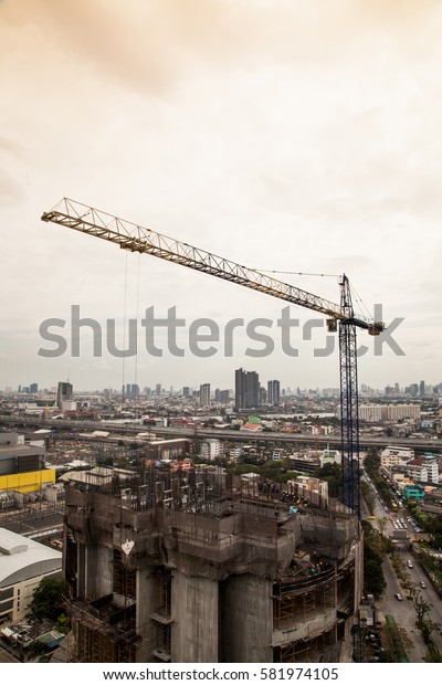 tower crane in the construction site of tall building in the capital of thailand