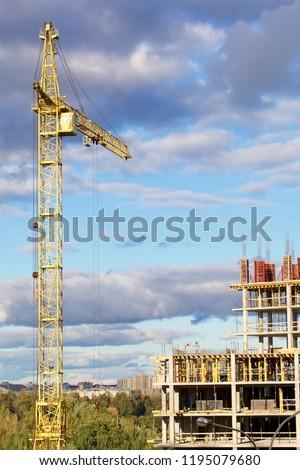 Tower Crane On Construction Building Frame Stock Photo (Edit