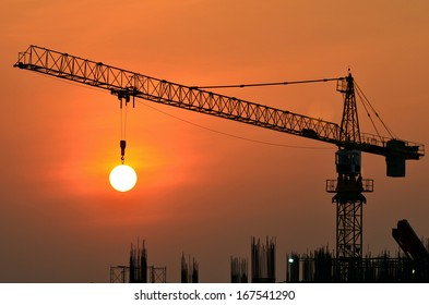 Tower crane on a construction site at sunrise