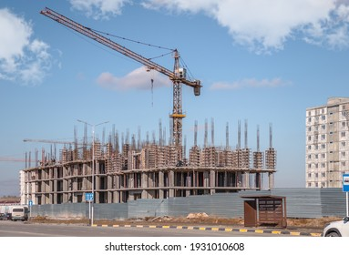 Tower crane on a construction site sky background. Construction of a high-rise building.
