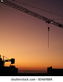 a tower crane at sunset
