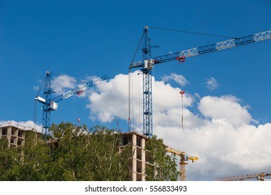 tower crane and unfinished high-rise building  in the summer