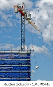 A tower crane working in high winds on new home units building site at 47 Beane St, Gosford, New South Wales, Australia - November 8. 2018: Construction and building progress update ne150