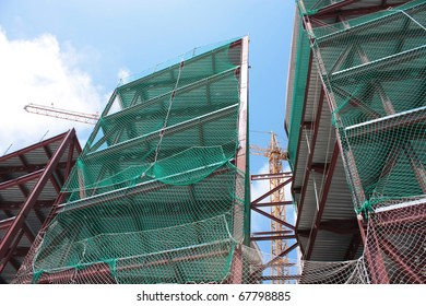 Tower crane works. Building under construction. Construction industry. Barcelona, Catalonia, Spain