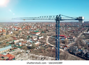 tower crane works on a construction site