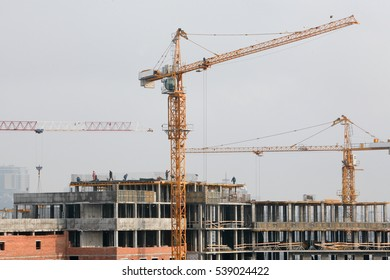 Tower cranes on the construction of residential buildings.