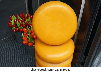 Tower Display of Traditional Dutch Cheese Wheels with Tulips Accents