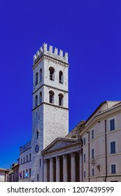 Tower and entrance of Temple of Minerva, an ancient roman building now a church, in Assisi, Italy