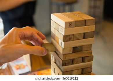tower game being played by an asian man