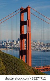 Tower of Golden Gate Bridge with San Francisco cityscape