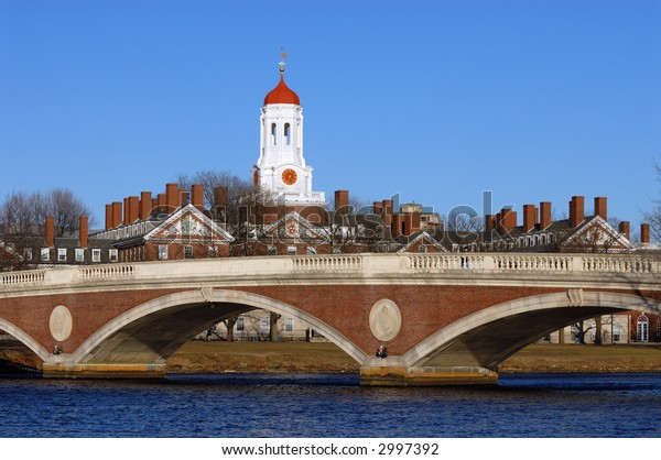 The tower of Harvard University's Dunster House and John W. Weeks Bridge over Charles River, in Cambridge, Massachusetts.