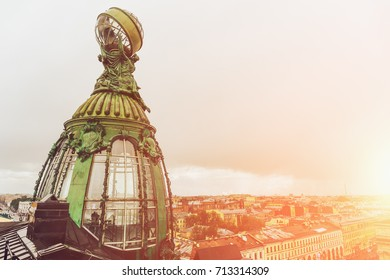 Tower of House of Singer or Zinger, also House of Books on Nevsky Prospekt, St. Petersbyrg, Russia, the office of VKontakte company (Russian social network). Old bronze tower in sunlight