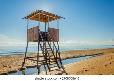 Tower for a lifeguard on a sea beach on a sunny day.