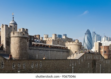 The Tower of London with London City skyscrapers in a background, UK