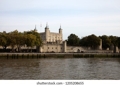 The Tower of London England - October 10 2015: View of theTower of London showing the Traitor's  Gate taken from a boat on the River Thames London