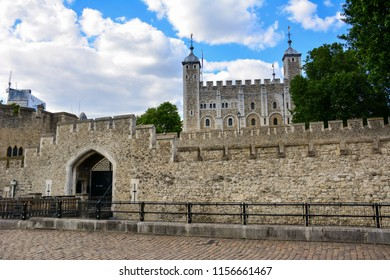 The Tower of London, a historic castle in the center of London, England, seen from the bank of the Thames with the Traitor's Gate, an entrance to the castle used for the arrival of prisoners