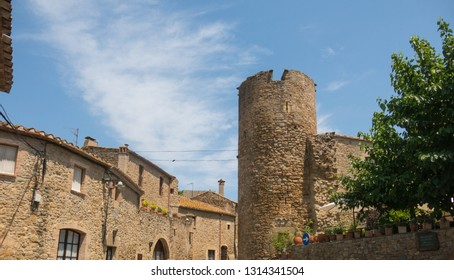 The tower of the medieval castle of Ullastret in the heart of Costa Brava. Baix Emporda, Catalonia, Spain.