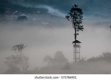 Tower in the morning view point with mountain mist in Khao Takhian Ngo at khao kho is  most famous travel place in thailand