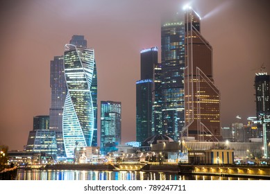 tower of Moscow city against the background of the night city, embankment in Moscow in the evening