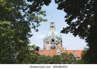 tower of New City Hall in Hannover Germany framed by trees