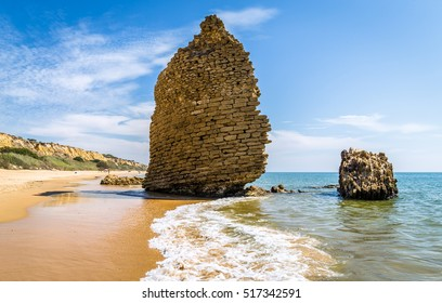 Tower on the beach Torre del Loro in Mazagon ,Huelva ,Atlantic coast ,Andalusia , Spain