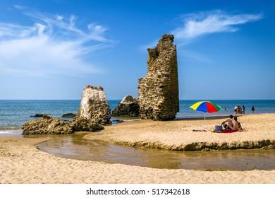 Tower on the beach Torre del Loro in Mazagon ,Huelva ,Atlantic coast ,Andalusia , Spain