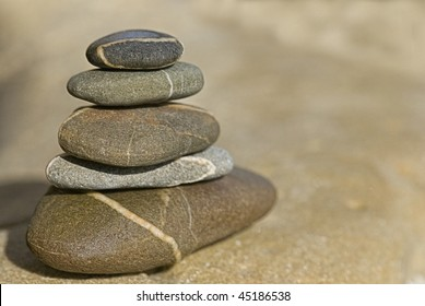 tower of pebble on a rock
