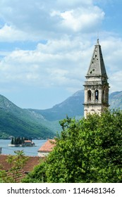 Tower of Perast Church, Saint Nicholas (Sveti Nikola) with the bay of Kotor in the background. The church and the village of Perast are among the main landmarks of the Kotor Gulf