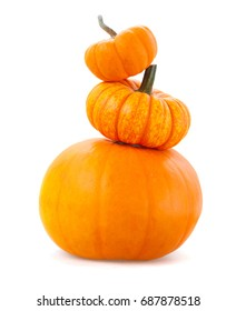 Tower of pumpkins isolated on white background