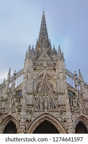 Tower of the Roman catholic Saint Maclou church in flamboyant gothic style with spires and arches in Rouen, Frane