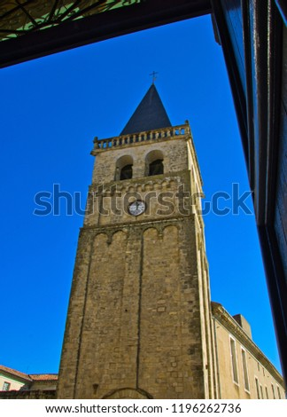 The tower of Saint Benoit seen from the door of the cathedral