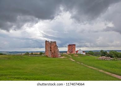 Tower Shchitovka and the church tower. Ruins of Mindovg Castle. Novogrudok. Belarus
