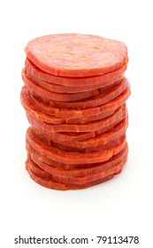 Tower of slices of salami isolated on white