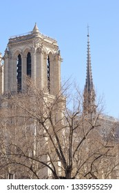 A tower and a spire from Notre-Dame cathedral, Paris, France