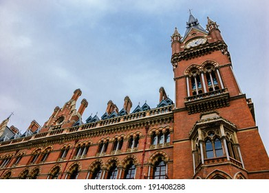 A tower of  St Pancras International Railway Station against cloudy sky. London, UK.