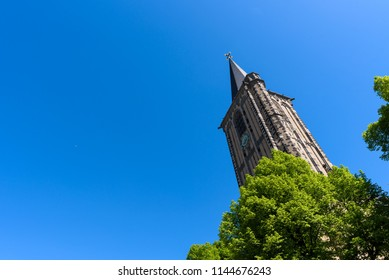 The tower of St. Severin, Cologne, an ancient Catholic church with Romanesque architecture & some features dating from the 10th century.