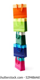 Tower stack of colorful shopping or gift bags isolated over the white background
