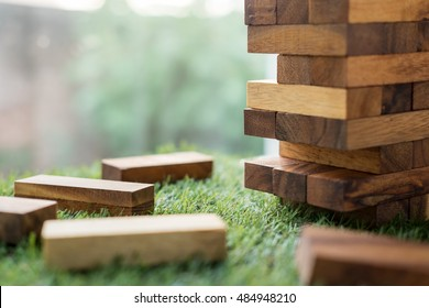 The tower stack from wooden blocks toy on grass
